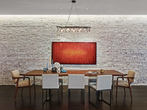 Industrial-minimal-dining-room-with-a-whitewashed-brick-wall-backdrop