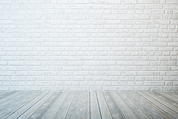 empty room with white brick wall and wooden floor