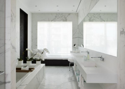 ma3_bathroom-modern-penthouse-design-with-white-marble-wall-and-flooring-tiles-plus-vanity-with-towel-hooks-and-shelves-plus-sofa-in-the-corner