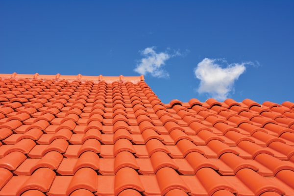 red roof texture tile and blue sky with cloud in background